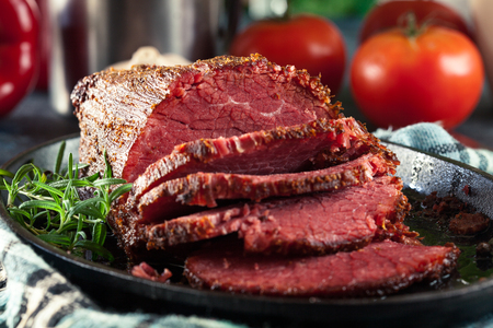 Slices of roast beef on cutting board