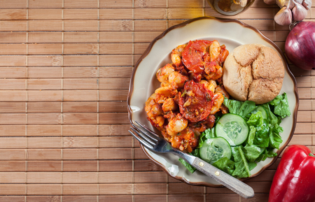 Baked giant beans with tomato sauce. Greek traditional food