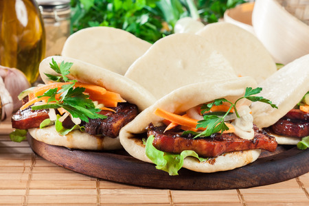 Gua bao, steamed buns with pork belly and vegetable. Asian cuisine