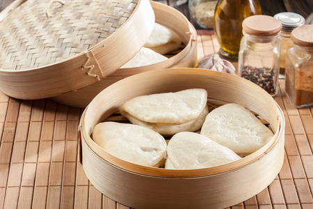 Gua bao, steamed buns in bamboo steamer. Asian cuisine Stock Photo