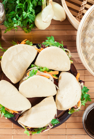 Gua bao, steamed buns with pork belly and vegetable. Asian cuisine. Top view