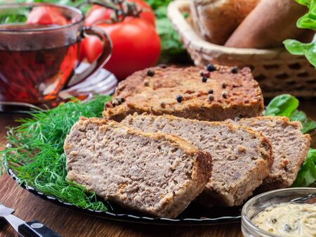 Homemade delicious meat pate with chicken liver on a plate