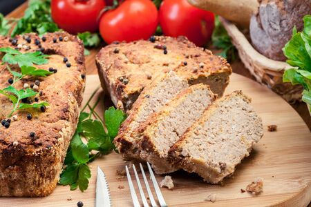 Traditional delicious meat pate with chicken liver on cutting board