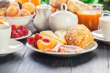 Fresh and continental breakfast table with ham and cheese