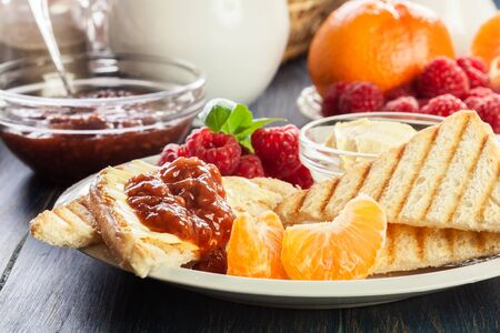 Fresh and continental breakfast table with jam on toast 写真素材