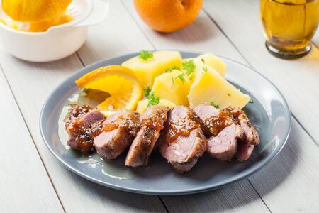 Roast duck breast with orange sauce served with potato Stok Fotoğraf