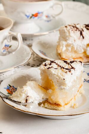 Apple cake. Fresh sweet apple cake with whipped cream served with cup of tea