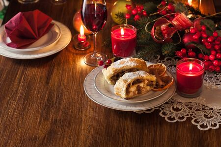Traditional puff pastry strudel with apple, raisins and cinnamon. Christmas table