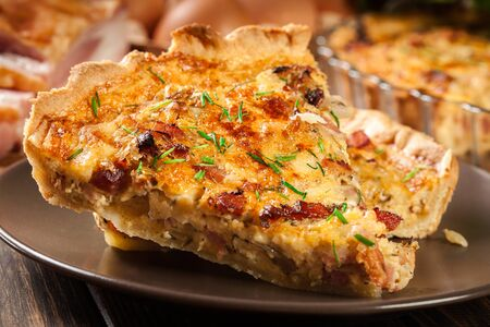 Pieces of quiche lorraine with bacon and cheese. French cuisine