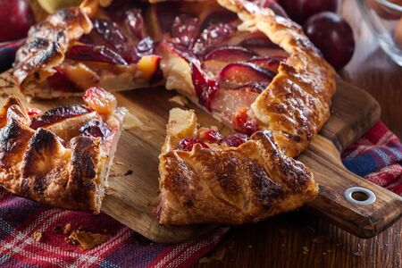 Galette with pears and plums. Rustic open pie. French cuisine 版權商用圖片