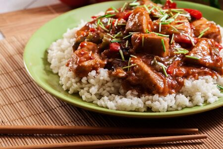 Delicious chicken in sweet and sour sauce served with rice Stock fotó