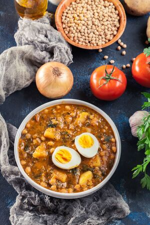 Chickpea stew with cod. Traditional Spanish dish usually prepared in Holly Week and Lent. Potaje de Vigilia
