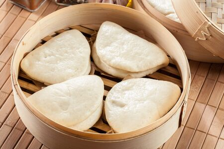 Gua bao, steamed buns in bamboo steamer. Asian cuisine