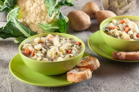 Vegetable soup with ingredients cauliflower,  carrot, potato and parsley on a plate  Stock fotó
