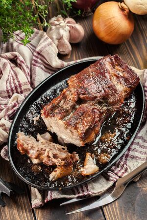 Still hot baked pork belly or bacon. Roasted meat