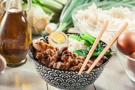 Taiwanese braised pork over rice with boiled egg and pak choi. Traditional dish Фото со стока