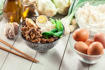 Taiwanese braised pork over rice with boiled egg and pak choi. Traditional dish