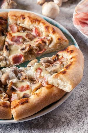 Pizza Bianca with bacon and mushrooms. Italian dish Фото со стока