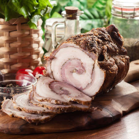 Baked pork belly roulade. Sliced bacon rolls