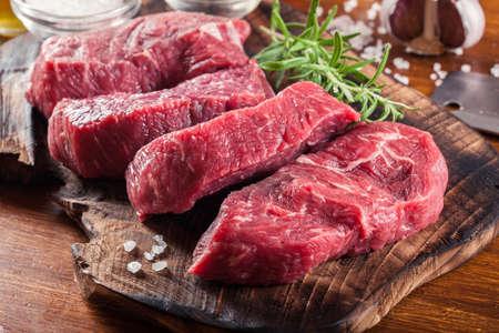 Raw beef steak on a cutting board. Making steak for grilling Archivio Fotografico