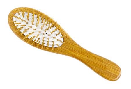 Wooden hairbrush isolated on white background