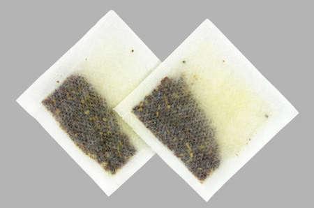 Rosehip tea bags isolated on gray fon