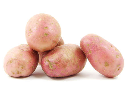 russet potato: Red potatoes shot from close on a white background