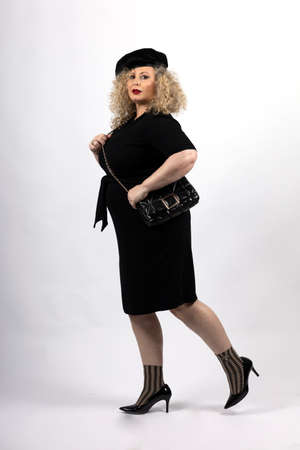 mature plus size model woman wearing black clothes, xxl woman on white background