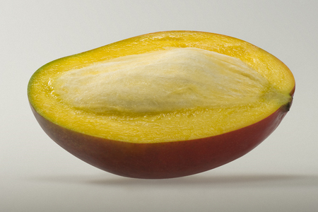 pip: Mango fruit with pip half