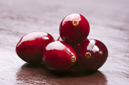 retouched: Wild cranberries on wooden background. Studio shot retouched Stock Photo