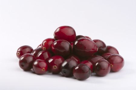 retouched: Wild cranberries isolated on white with smooth drop shadow. Studio shot retouched Stock Photo
