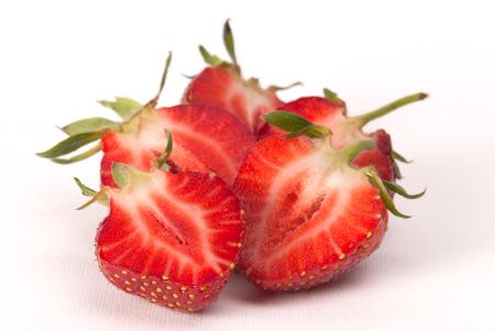 midsagittal: Tasty fresh strawberry isolated on white background. Studio shoot.