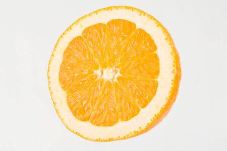 dring: Part of ripe juicy orange. Studio shoot.