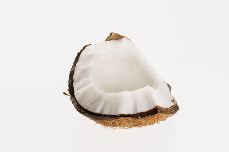 copra: Fresh coconut on white isolated background. Studio shoot. Stock Photo