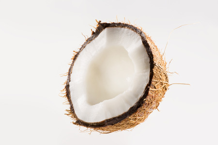 copra: Fresh coconut on white isolated background. Studio shoot. Stock Photo