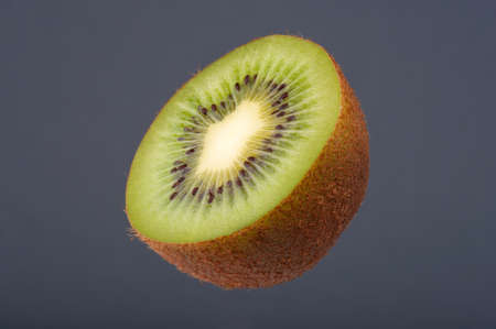 half full: Ripe Juicy Kiwi Fruit, Half Full. Studio shoot retouched. Stock Photo