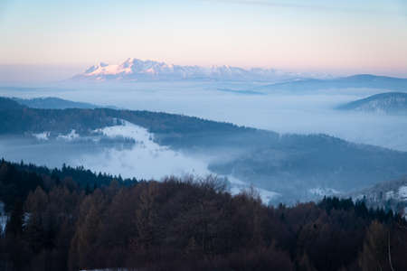 Tatra mountain view in the morning. Fogs in the valleys.
