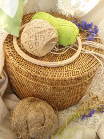 basket embroidery: threads for needlework on a basket