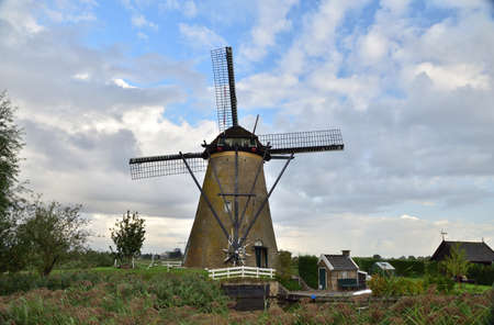 Windmills at Kinderdijk on a cloudy summer day in the Netherlands. Summer.