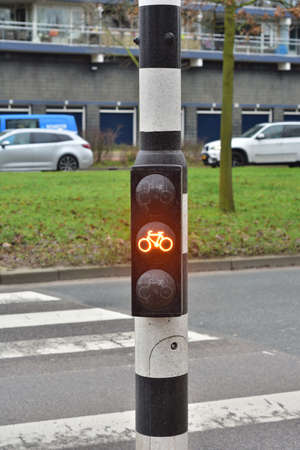 Yellow warning light for cyclists, beware of danger. Yellow light.