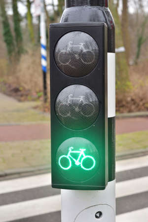 Green light on the traffic light for cyclists, you can go. Green light.