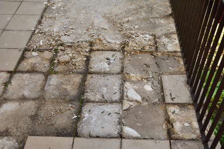 Chipping off old tiles on the terrace during renovation, replacing them with new ones. Terrace.