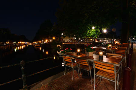 A night in Amsterdam. Light streaks of a boat flowing down the canal. Summer.