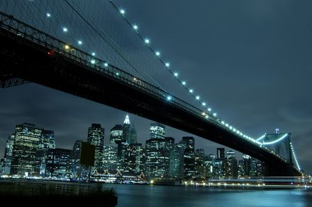 Manhattan skyline and Brooklyn bridge at night Stock Photo - 2840298
