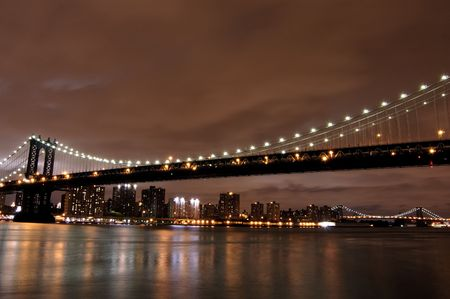 Manhattan bridge and skyline at night Stok Fotoğraf