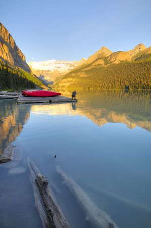 louise: Boat dock on Lake Louise in the early morning light Stock Photo