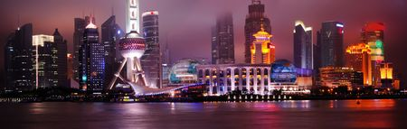 futuristic city: Shanghai Pudong modern skyline at night