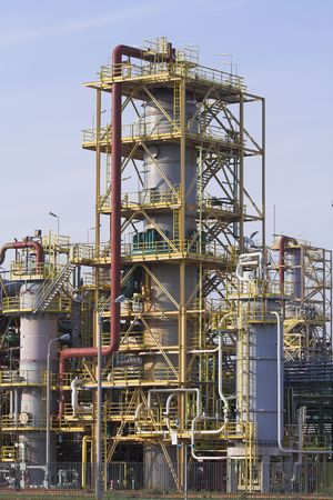 tall chimney: view of elements of chemical refinery