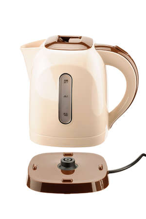 Beige and brown color plastic cordless electrical kettle with base isolated on the white background