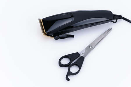 Close up of Electric hand-held hair clipper with accessory for hair salon or barber shop on the white background with copy space